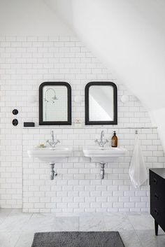 white bathroom with black mirrors |