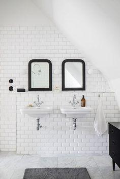 white bathroom with black mirrors |