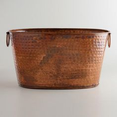 One of my favorite discoveries at WorldMarket.com: Hammered Copper Tub  I'm thinking possibly a sink?