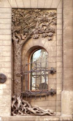 beautiful ornate window with tree detailing - architecture
