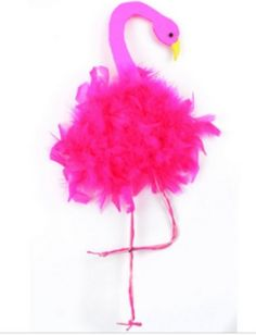 Kids will love making this fun and fluffy flamingo craft this summer!