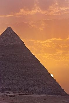 The sun setting behind the Pyramid of Khafre in Giza, UNESCO World Heritage Site, near Cairo, Egypt, North Africa, Africa