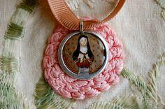 Saint Teresa of Lisieux devotional medal, plain case. $14.00, via Etsy.
