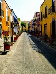 Colourful Street in Puebla, Mexico. The street colours are calming as they are attractive to those passing by. Reds, oranges, blues and yellows dominate tourist and non-tourist places alike. Beautiful Streets, Beautiful Places, Places Ive Been, Places To Visit, Tourist Places, Mexico Travel, Around The Worlds, Explore, Outdoor