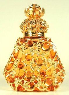 Jeweled gold tone filigree with orange stones perfume bottle