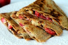 Peanut butter, Strawberry, & Banana Quesadillas from ambitiouskitchen.com    This is going to be breakfast in the morning! =)
