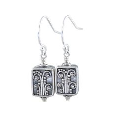 These Sterling Silver Bali Botanical Flower dangle earrings are simple yet stylish. The earrings feature rectangle balinesian textured dangles with an antiqued blackened finish on the sterling silver.
