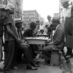 Men face off in stiff competition as boys look on, Harlem, 1938.  Hansel Mieth—The LIFE Picture Collection/Getty Images
