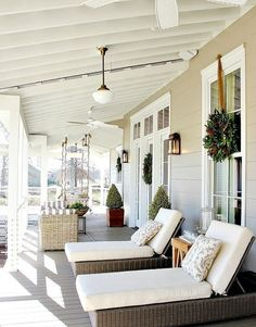 back porch with loungers and a swining sofa to sunbathe