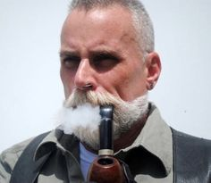 All men should have bushy mustaches. Man Smoking, Cigar Smoking, Pipe Smoking, Cigar Men, Pipes And Cigars, Beard No Mustache, Hair And Beard Styles, Facial Hair, Bearded Men