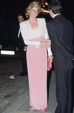 1984 Diana is pretty in pink while attending the ballet Swan Lake.  via @AOL_Lifestyle Read more: http://www.aol.com/article/2016/06/29/princess-dianas-gravesite-is-getting-a-multimillion-dollar-make/21421568/?a_dgi=aolshare_pinterest#fullscreen