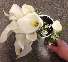 Calla lily bridal bouquet with matching boutonniere package. $85