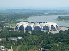 Located in the heart of Pyongyang, North's Korea capital city, May Day Stadium looms over the adjacent Taedong River in the shape of a magnolia blossom. This Side Of Paradise, Paradise City, North Korea Facts, Inside North Korea, 10 Interesting Facts, Most Popular Sports, Camp Nou, Futuristic Architecture, Capital City