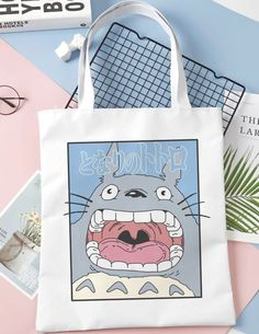 Rely on this tote bag to carry your books, groceries, and everyday essentials. It features a high-quality print that does not fade. Tote Bags For School, Back To School Bags, Diy Tote Bag, Reusable Tote Bags, Tod Bag, Doodle Characters, Studio Ghibli Movies, School Essentials, My Neighbor Totoro