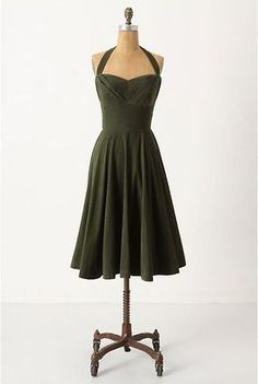 This can't help but be flattering with it's fitted waist, interesting neckline, and great length.