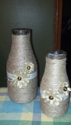 Vases wrapped in twine & embellished with flowers made of ribbon and buttons.