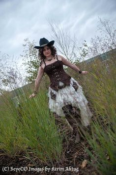 Western Canadian Steampunk Cowgirl Skirt by Nightshade Corset, Coat and Pants by Maggie Walt, Fan by In the Attic, Pouches by Clockwork couture, Corset by Corset Story Photo by SeyeCo Images, Cosplayer: Empress Cosplay