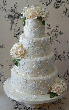 Ivory 4-tier wedding | http://specialweddingcakeforyou90.lemoncoin.org