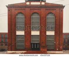 Image result for brick building with arched windows