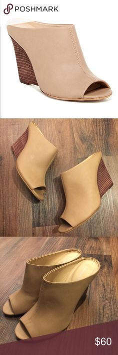 "Calvin Klein Mylee Open Toe Wedge Mules Calvin Klein Mylee Open Toe Wedge Mules.  Leather.  Wedge stacked heel.  3 7/8"" heel.  Some small scuffs as shown in photo.  Overall great condition. Calvin Klein Shoes Mules & Clogs"