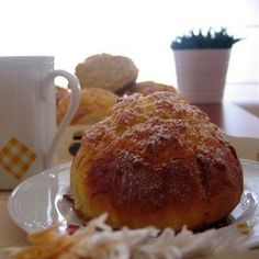 Sweet bread topped with gooey coconut...I could live on these...