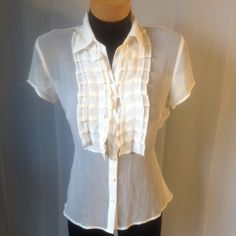 Chiffon top with Ruffles. Short sleeve top. String ties on back. Sheer material. Buttons up on front. Worthington Tops Blouses