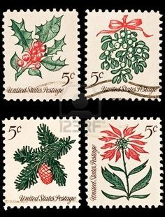 A variety of four Christmas postage stamps. Sprig of conifer, poinsettia, mistletoe and holly, Stock Photo