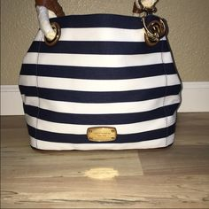 Michael Kors Navy Blue Purse Brand New With tags! Super cute for summer!! Good size really spacious. This is the NAVY BLUE Tote, I have a Black Striped one listed as well Michael Kors Bags