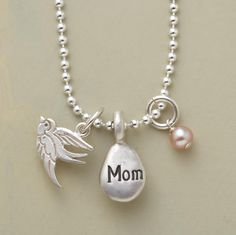 """JUST FOR MOM NECKLACE--This charm necklace for mom is a treasure created especially for Mother, our sterling silver chain dangling three charms: a robin, a droplet inscribed """"Mom"""" and a pink cultured pearl. Lobster clasp. Handmade in USA. 18""""L."""