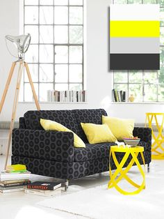 Grey's couch and yellow's acessories.