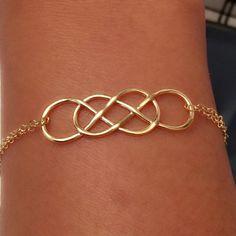 14k yellow gold infinity bracelet, 14k double infinity bracelet by EllynBlueJewelry on Etsy https://www.etsy.com/listing/165090671/14k-yellow-gold-infinity-bracelet-14k
