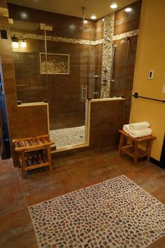 StoneMar Natural Stone Company LLCSaveEmail In this very Zen bath, there's red polished pebble mosaic tile on the floor of the shower (it's ...
