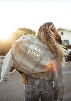 Girl power. Make your Trucker Jacket your own by painting on the back panel. Pair it with your favorite pair of dark wash jeans. Fabian Wester.