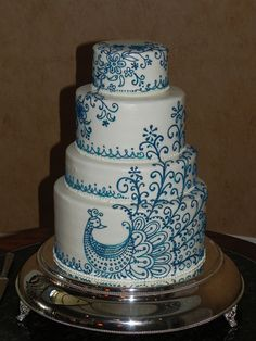 peacock cake. Good example of how colored piping looks on a white cake, though I don't love this particular cake.