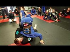 Back attack to arm triangle guillotine