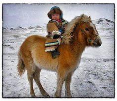 mongolian child on horseback