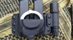 Double magazine pouch W/Handcuff pouch and flashlight holder