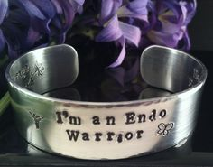 Hand Stamped Endometriosis Awareness CuffIm an by QuietMindDesigns, $30.00