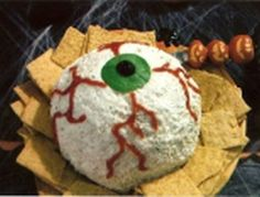 The eyes have it with this Halloween cheeseball.  See more Halloween appetizers and party ideas at one-stop-party-ideas.com