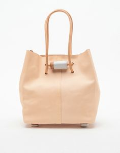 Tote bag by Jujumade, out of vegetable-tanned leather with a stoneware strap detail and ceramic feet.