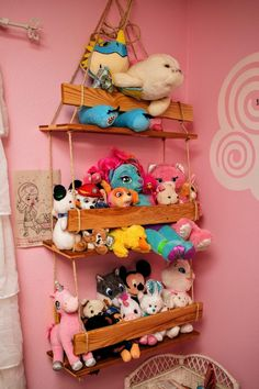 swinging stuffed animals - a cool DIY organization idea! Check this post for more organization ideas for stuffed animals!