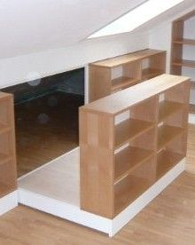 Hidden storage behind bookcase built into the attic eaves. Great idea!