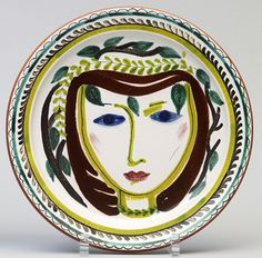 """Unique fayance plate by Stig Lindberg for Gustavsberg. Diam. 33cm/13"""". Signed with the """"Studio Hand"""" and Stig L."""