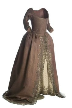 """Gown in """"French purple"""", 1790, Spain, silk, taffeta, silver, cotton, linen, metallic lace applied to silver wound silk. In Spain this dress was """"vaquero hecho a la inglesa"""" [rough translation: cowboy in the manner of """"robe à l'anglaise] or just simply """"vaquero"""" [cowboy] Popular in the last decade of the eighteenth century. (c) Museo del Traje."""