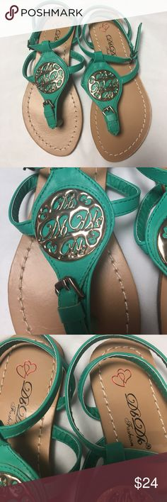 Mint green cross cross back sandals w/ medallion Adorable sandals with metal medallion T strap design adjustable straps. Choose your option from the choices listed. I only have the options shown and will NOT restock. See my closet for other colors DBDK Shoes Sandals