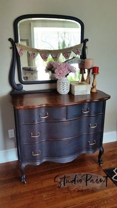 This lovely serpentine painted antique dresser has been painted with Annie Sloan Chalk Paint in Graphite and finished with General Finishes Gel Stain