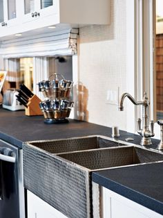 Hammered Farmhouse Kitchen Sink looks nice next to dramatic dark (black?) counter tops (soapstone perhaps?)