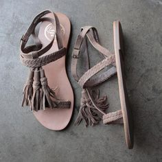 Made from rich vintage suede leather. Adjustable buckle closure. Braided straps offer textural appeal. Open toe leads to a tasseled T-strap. Breathable leather