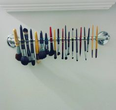 Don't know where to dry all your makeup brushes? Hang them on your towel rack with tiny, elastic ponytails. | 15 Kick Ass Hacks You've Never Heard Of But Will Immediately Want To Try