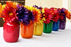 Rainbow Mason Jars filled with bright flowers